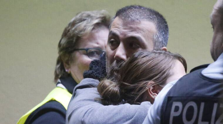 People waiting for flight 4U 9525 are led away by airport staff at the airport in Duesseldorf, Germany, Tuesday, March 24, 2015, after a Germanwings passenger jet carrying more than 140 people crashed in the French Alps region as it traveled from Barcelona to Duesseldorf. (AP Photo/Frank Augstein)