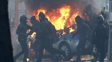 3 police cars set on fire in protests outside European Central Bank HQ inGermany