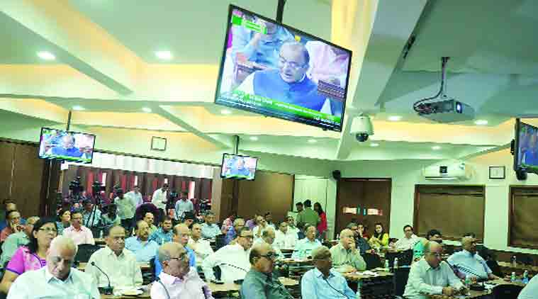Members of the Gujarat Chamber of Commerce and Industries watch Arun Jaitley presenting the Budget, at GCCI office in Ahmedabad Saturday. (Source: Javed Raja)