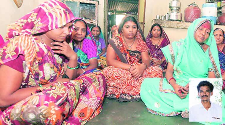 Relatives of Jayanti Gohil (inset) mourn his death, in Vadodara on Monday. (Source: Express photo by Bhupendra Rana