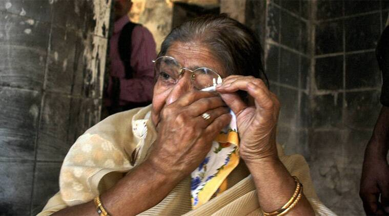 Wife of victim Ehsaan Jafari wipes her tears as she visits her old house at Gulbarg Society, on the 10th anniversary of the carnage in Ahmedabad.