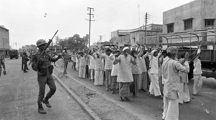 "May 1987:  This photo shows Army personnel lining up a group of men from Hashimpura. Among those in the frame is Md Yaseen (in skullcap and beard), who went missing ever since. It was from one such photographs that Yaseen's son identified him. With the number of victims not established, the prosecution used the photo as ""clinching evidence"" to build a case for compensation for 42 families, besides five survivors."