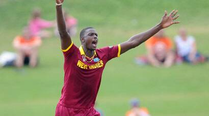 West Indies sink jaws into quarter-final berth after dominant win overUAE