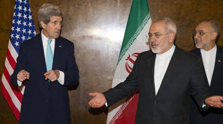 U.S. Secretary of State John Kerry (L) and Iran's Foreign Minister Mohammad Jawad Zarif (C) gesture as they arrive to resume nuclear negotiations in Montreux, in this March 2, 2015. (Source: Reuters/file photo)