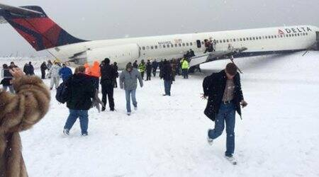 Plane skids off runway in New York, raises questions on snow closures
