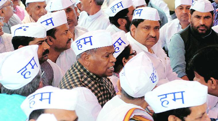 Manjhi protests alongside MLAs, MLCs and supporters of the Hindustan Awam Morcha (HAM), in Patna Monday.(Source: Express photo Prashant Ravi)