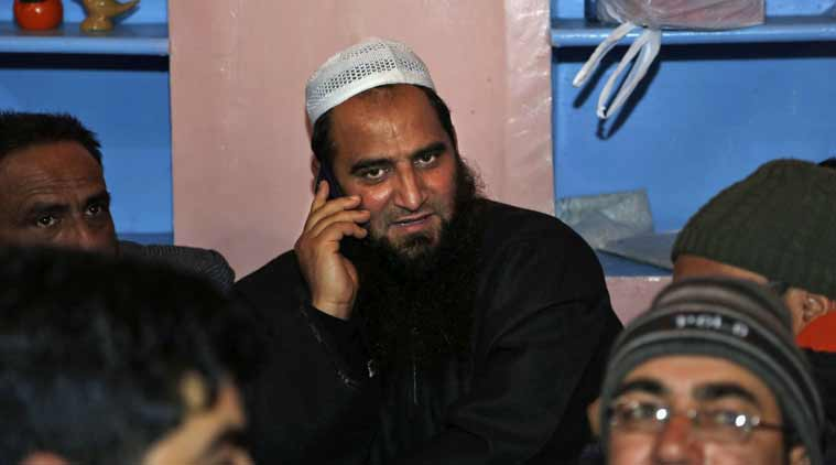 masrat alam, under house arrest, pakistan flag, masrat, geelani
