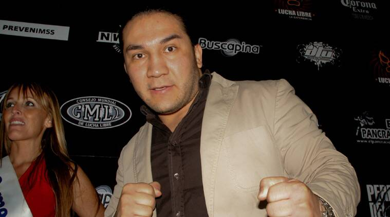 In this May 27, 2010 photo, Mexican wrestler Pedro Aguayo Ramirez, known as Hijo del Perro Aguayo, poses for photographers at the start of a news conference in Mexico City.