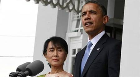 U.S. President Barack Obama speaks to the media alongside Myanmar's opposition leader Aung San Suu Kyi at her residence in Yangon November 19, 2012.