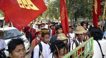 Students face off against Myanmar police outsideYangon