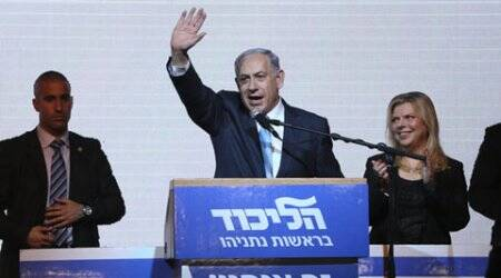 Israeli Prime Minister Benjamin Netanyahu greets supporters at the party's election headquarters in Tel Aviv.