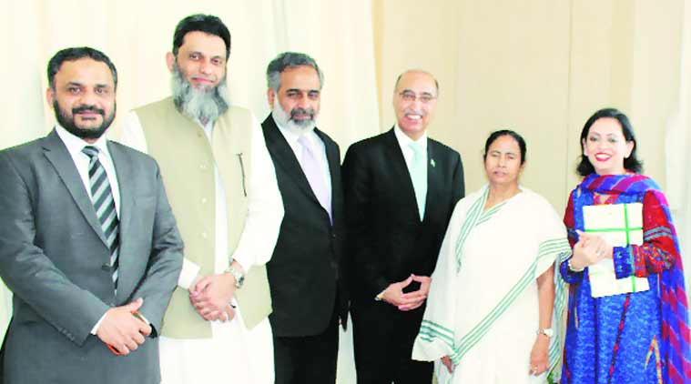 Pakistan Highh Commissioner Abdul  Basit and others with West Bengal Chief Minister Mamata Banerjee, in Kolkata on Wednesday.(Source: Express Photo)