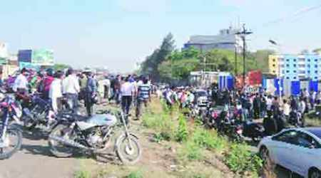 Parked bus 'rolls' , kills 2bystanders