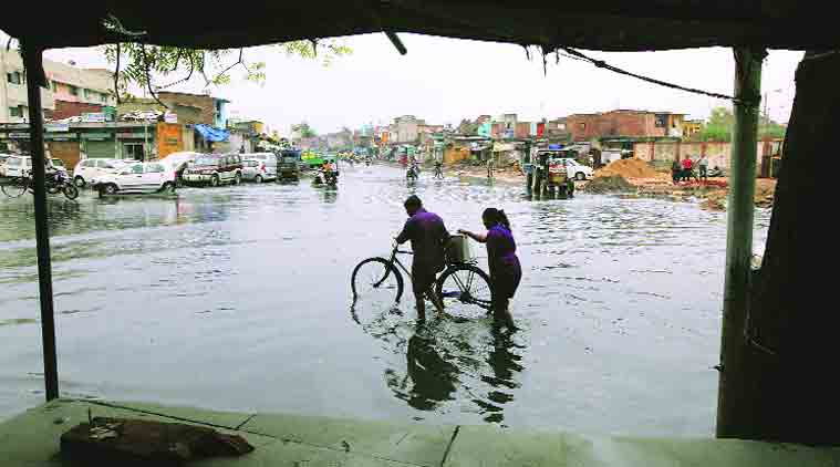 A waterlogged area in Ahmedabad on Sunday. (Source: Express photo by Javed Raja)