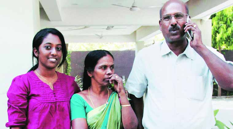 Rinu Srinivasan with her parents on Tuesday. (Source: PTI)