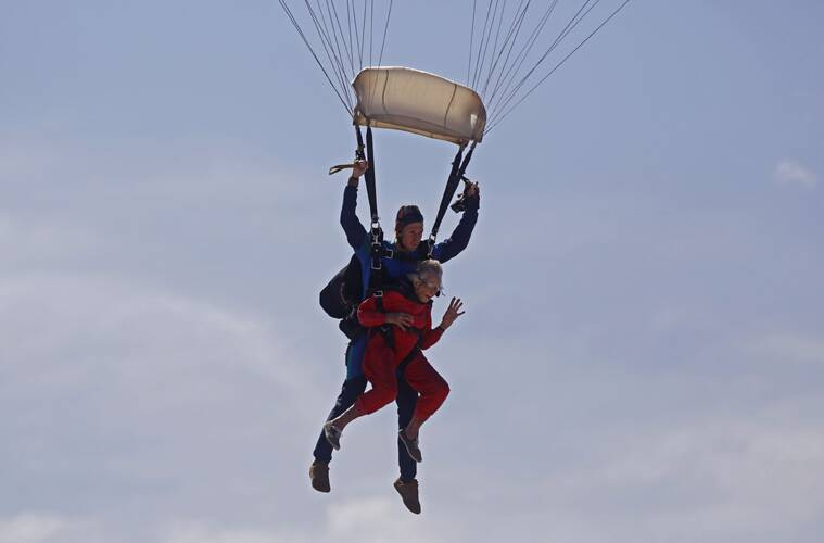 Georgina Harwood, foreground, in mid air with Jason Baker, during her tandem parachute jump forming part of her birthday celebrations, in Cape Town, South Africa. (Source: AP)