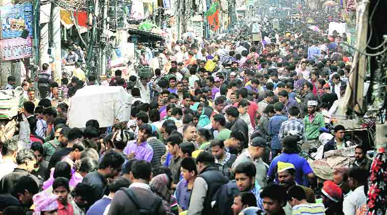 The rush in Sadar Bazar on the eve of Holi. (Source: Express photo by Ravi Kanojia)