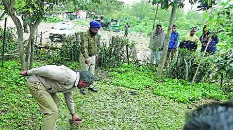 Policemen on leopard trail in Dhanas Milk Colony in Chandigarh on Sunday.