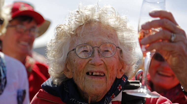 Centenarian Georgina Harwood, celebrates after her tandem parachute jump forming part of her birthday celebrations, in Cape Town, South Africa, Saturday, March 14, 2015. Harwood, who celebrated her 100th birthday on Tuesday, completed her third tandem parachute jump in front of family and friends. (Source: AP)