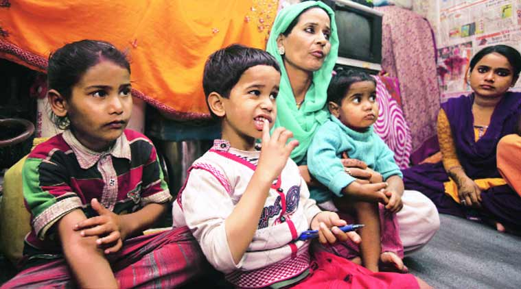 The three children with their mother Tabassum on Wednesday. (Source: Express Photo by Amit Mehra)