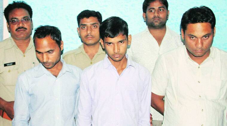 The accused in police custody, in Lucknow, Monday. (Source: PTI photo)