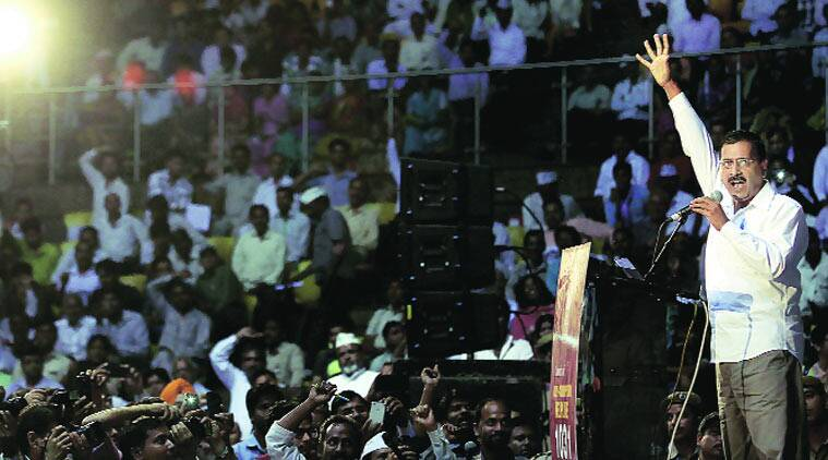 Arvind Kejriwal at the launch of the helpline at Talkatora Stadium on Sunday. (Source: Express photo by Ravi Kanojia)