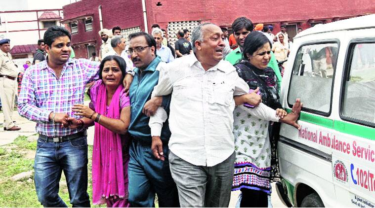 Family members of Deepak Sharma who died in the accident, at General Hospital, Ambala Cantt, on Tuesday. (Source: Express photo bySumit Malhotra)
