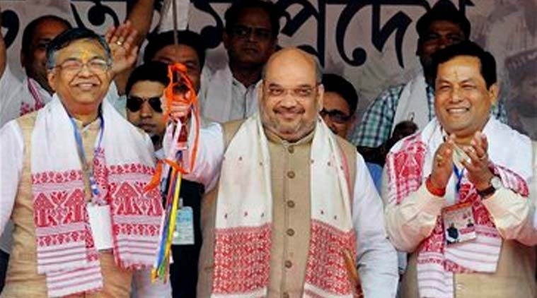 BJP National President Amit Shah being felicitated with a sword during the BJP Janajagaran Samaroah at Khanapara in Guwahati on Sunday. (Source: PTI)