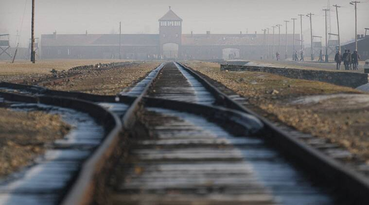 FILE - The Jan 17, 2005 file photo rails in the former Nazi death camp Auschwitz-Birkenau in Oswiecim, southern Poland. One of the black-uniformed men on the ramp where people arrived was likely SS guard Oskar Groening who goes on trial Tuesday, April 21, 2015 in a state court in the northern city of Lueneburg on 300,000 counts of accessory to murder. (AP Photo/Czarek Sokolowski, file)