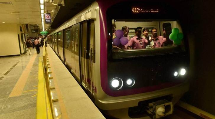 Bengaluru : Metro drivers celebrate as the train starts from B R Ambedkar Vidhan Soudha Metro station after flagging off the Underground Metro Route from Cubbon Park-Magadi Road in Bengaluru on Friday. PTI Photo by Shailendra Bhojak(PTI4_29_2016_000279A)