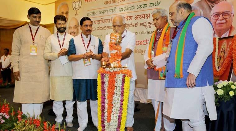 BJP president Amit Shah, vice-president of BJP B S Yeddyurappa with other leaders during the inauguration of the National office bearers meeting in Bengaluru on Thursday. (Source: PTI photo)