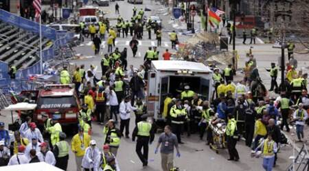 In this April 15, 2013, file photo, medical workers aid injured people following an explosion at the finish line of the 2013 Boston Marathon in Boston. Three people were killed and more than 260 were injured when twin pressure-cooker bombs exploded near the finish line. (Source: AP Photo)