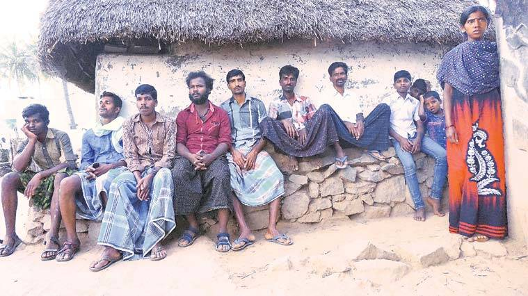 Villagers in Jamunamaruthur, Jawadhu Hills, wait for the funeral of five of their own.