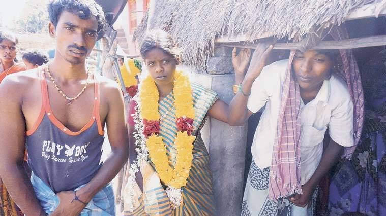 Nadia, 18, at the funeral of her husband Rajendran. He was among the 20 woodcutters killed in the forests of Seshachalam in Andhra Pradesh.