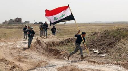 Iraqi teams start exhuming mass grave of soldiers killed by IS in Tikrit