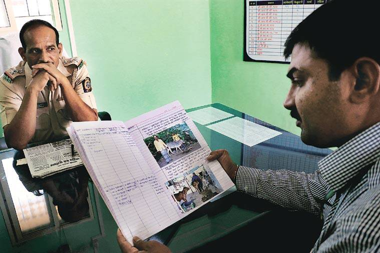 Photographs of cattle and their owners are pasted in registers titled 'Gaya, Bail, Bachara' at Malegaon's seven police stations.