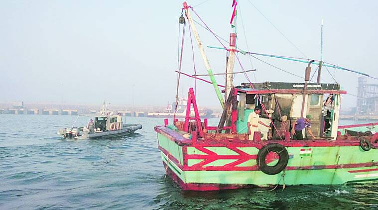 The police check a fishing trawler near Porbandar port as part of drill on Thursday. (Source: Express photo)