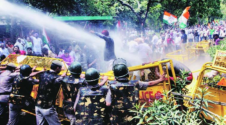 Police use water cannons to disperse Congress workers protesting against Tomar on Thursday. (Source: Express Photo by Prem Nath Pandey)