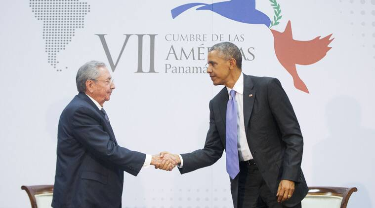 US President Barack Obama and Cuban President Raul Castro shake hands at the Summit of the Americas in Panama City, Panama, Saturday, April 11, 2015. (AP Photo/Pablo Martinez Monsivais)
