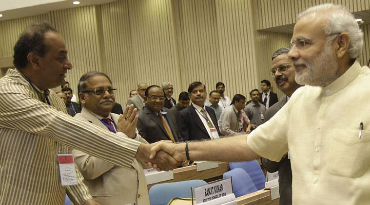 Attorney General Mukul Rohatgi (L,) Chief Justice of India H.L. Dattu and Prime Minister Narendra Modi at joint conference of chief ministers of states and chief Justices of the High Courts in New Delhi on Sunday. (Source: Express photo by Neeraj Priyadarshi)