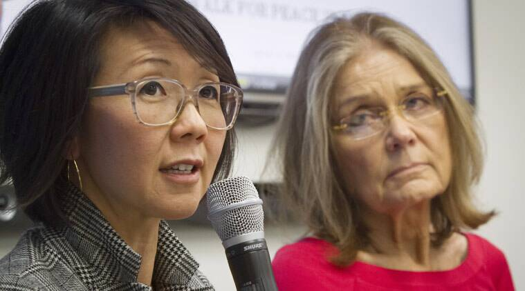 """FILE - Organizers of the effort called WomenCrossDMZ.org, including lead coordinator Christine Ahn, left, and honorary co-chair Gloria Steinem, right, hold a United Nations news conference announcing plans for a rare and risky women's walk across the demilitarized zone between North and South Korea to call for reunification, in this March 11, 2015 file photo. Ahn said in an email Friday April 3, 2015 they have Pyongyang's cooperation and support."""". (AP Photo/Bebeto Matthews, File)"""