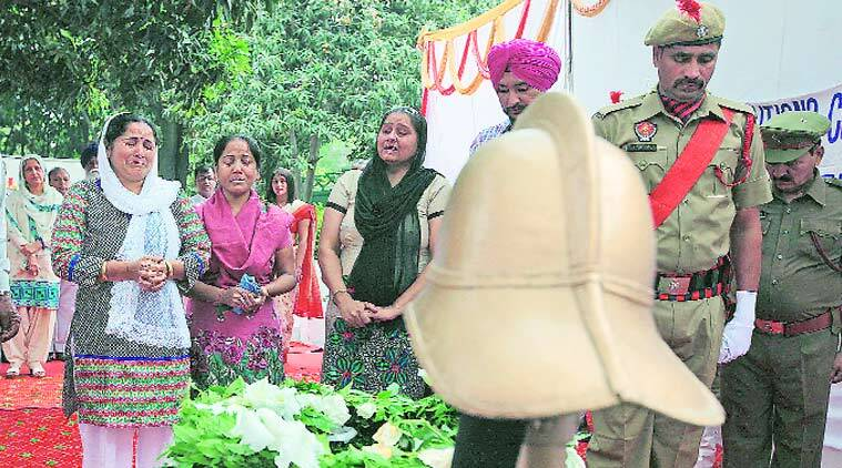 Family members of martyred firemen pay homage at  Sector 17 fire station in Chandigarh on Tuesday.