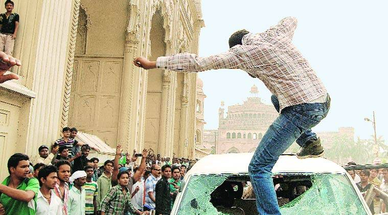 Rage in the machine: A mob takes out its anger on cars in Lucknow. (Source: Express photo by Vishal Srivastava)