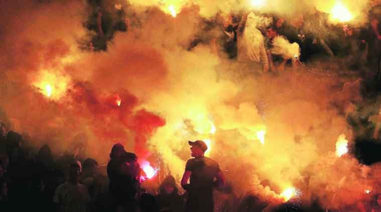 Fans threw stones and battled with sticks and also hurled flares onto the pitch.