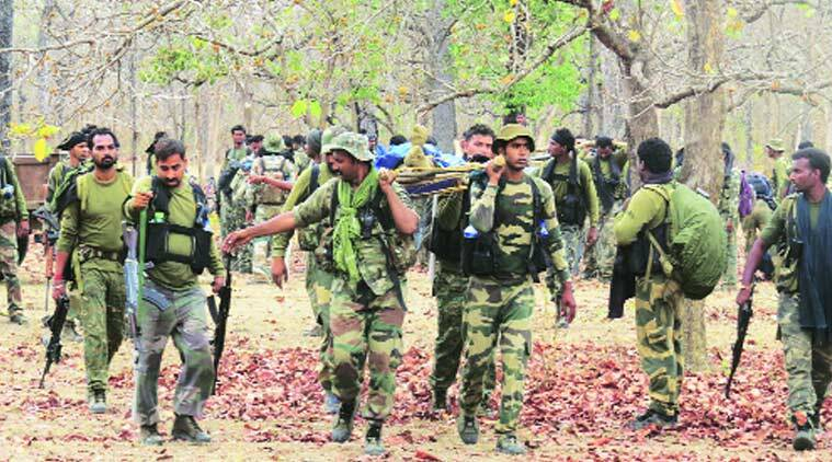 Security personnel carry bodies of STF jawans killed in the encounter in Sukma district, Sunday. (Source: Express photo by Ashutosh Bhardwaj)