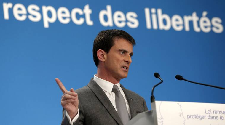 French Prime Minister Manuel Valls speaks during a news conference at the Elysee Palace in Paris, Thursday, March 19, 2015. France's government pressed a surveillance bill Thursday that would give French intelligence services legal backing to vacuum up metadata in hopes of preventing an imminent terror attack. Text in background reads: respect freedom. (AP Photo/Philippe Wojazer, Pool)