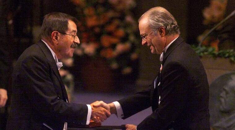 FILE - In this Dec. 10, 1999 file photo German author Guenter Grass, left, receives the Nobel Prize for literature from Swedish King Carl XVI Gustaf, right, at the Concert Hall in Stockholm, Sweden. (Source: AP)