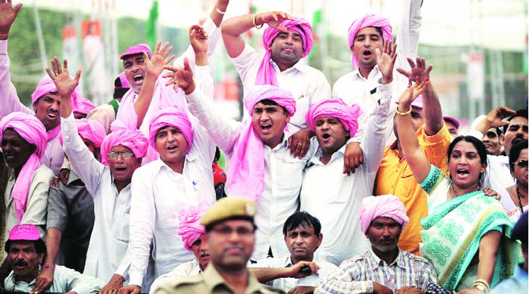 Bhupinder Singh Hooda's supporters express themselves at Rahul Gandhi's rally. (Express Photo by: Oinam Anand)