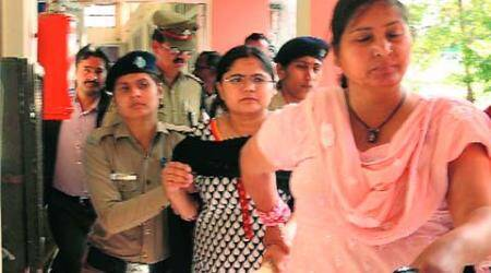 Women masquerading as IAS trainee held, guard suspended