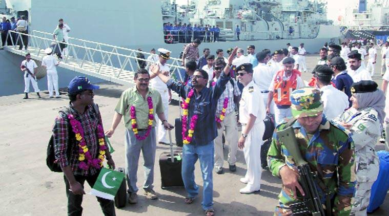 Indians evacuated from Yemen by a Pakistan Navy ship upon their arrival at Karachi port on Tuesday. (Source: AP photo)